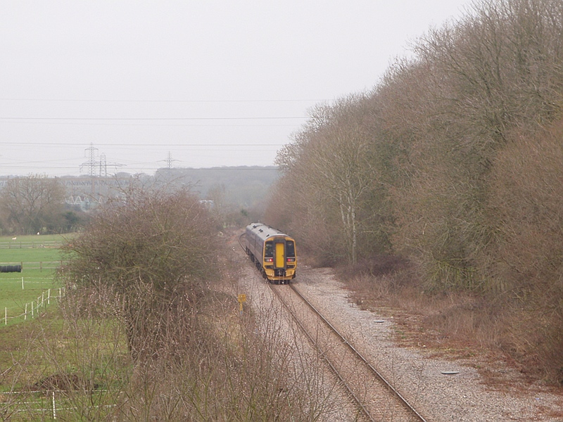 A train heads north from Melksham for Chippenham and Swindon