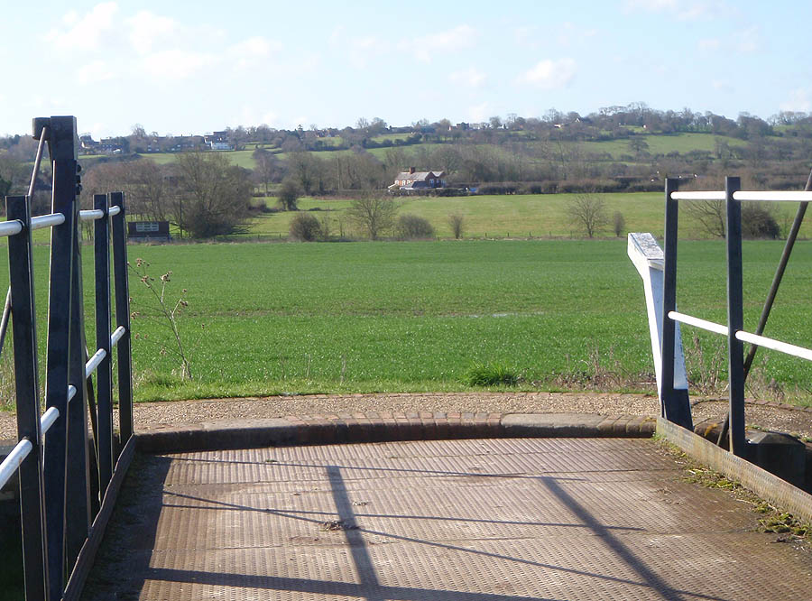 Over Swing Bridge to fields