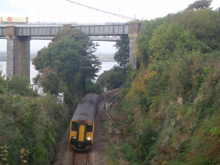 Train from Gunnislake passes under Tamar Bridges