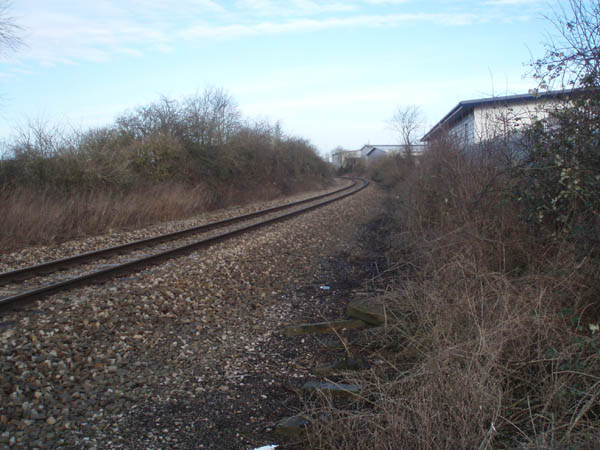 proposed site for station / transport interchange directly adjoining the site, showing ample land availability on site of former sidings.  Photograph taken from public footpath that crosses the railway at this point