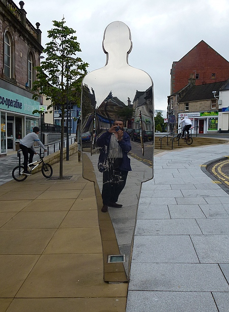 Reflective figures in Alloa town centre