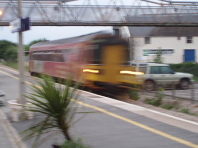 A class 153 passes Chippenham at speed