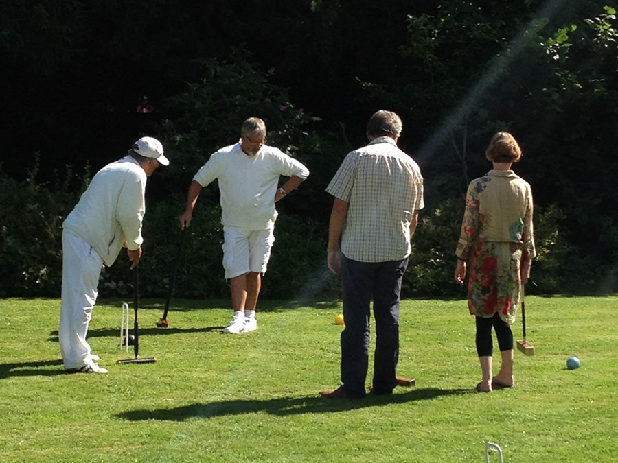 Playing the game of croquet at Well House Manor