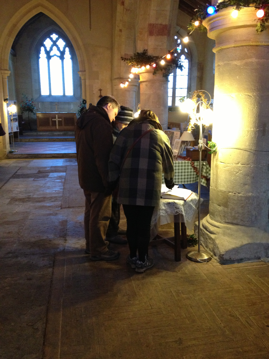 Signing the visitors book in Imber church
