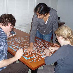 Delegates relax with a jigsaw after a long day of studying