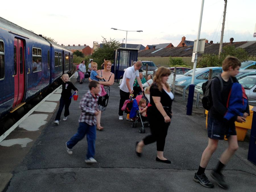 Crowd getting off train at Melksham