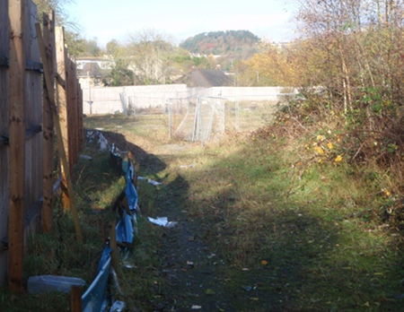 Behind the high fence - the old Radstock station site is just a piece of wasteland