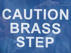 Brass step sign