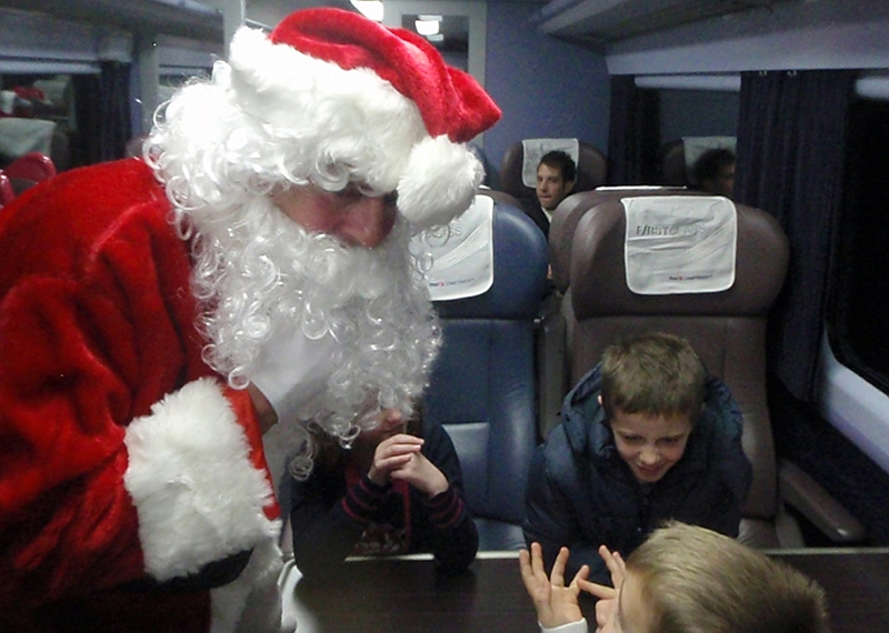 Santa had presents for all the young people on the train, and they were thrilled to meet him