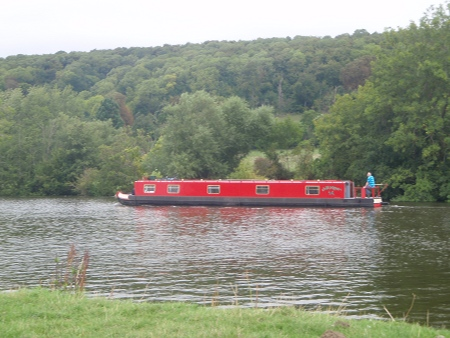 Narrowboat on river Thames above Mapledurham lock