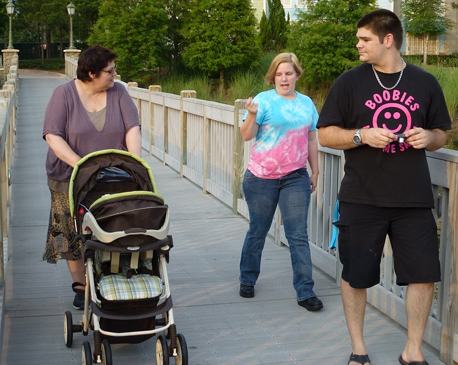 Family walk over the bridge