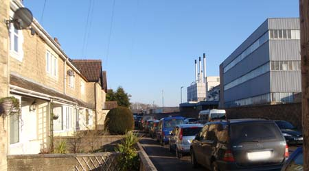 Houses and heavy industry just across the road from each other