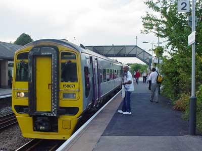 An early evening Weymouth train stops a Trowbridge in August 2005