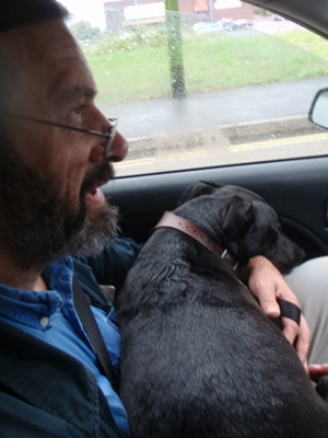 Dog in taxi (had to be on knee)