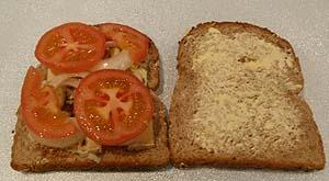 Add slices of tomato