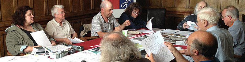 Volunteers at an MRUG meeting