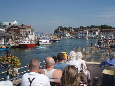 An Open Top bus in Weymouth Harbour area